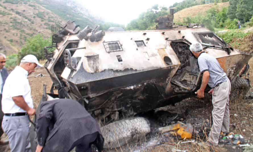 A destroyed army vehicle is searched in south-east Turkey