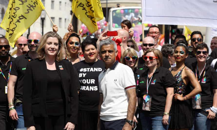 Sadiq Khan and Penny Mordaunt (left) open the Pride In London parade on Saturday.