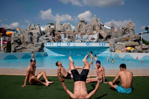 Swimmers rest beside a wave pool at the Munsu water park in Pyongyang.