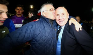 Accrington manager, John Coleman, gets a kiss to mark his success in taking the team out of League Two.