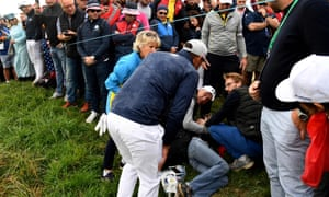 Brooks Koepka apologises after his tee shot drifted off course and hit a spectator.