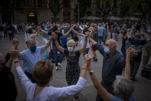 People dance the sardana, a traditional Catalan dance, in front of the cathedral in Barcelona