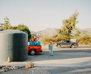 Residents fill up water from Doyle Colony Fire Station. East Porterville, Tulare County, California, USA, 2015
