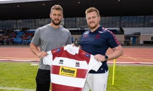 Aaron Moon (right) played rugby league as a youngster, and is now turning out in the same cherry and white as Wigan Warriors captain Sean O'Loughlin.