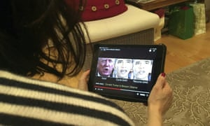 A woman watches a deepfake video of Donald Trump and Barack Obama.