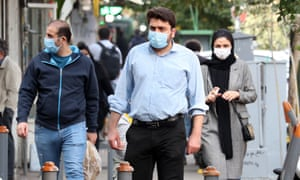 Iranians wearing face masks walk in a street in Tehran, Iran, 10 November 2020.
