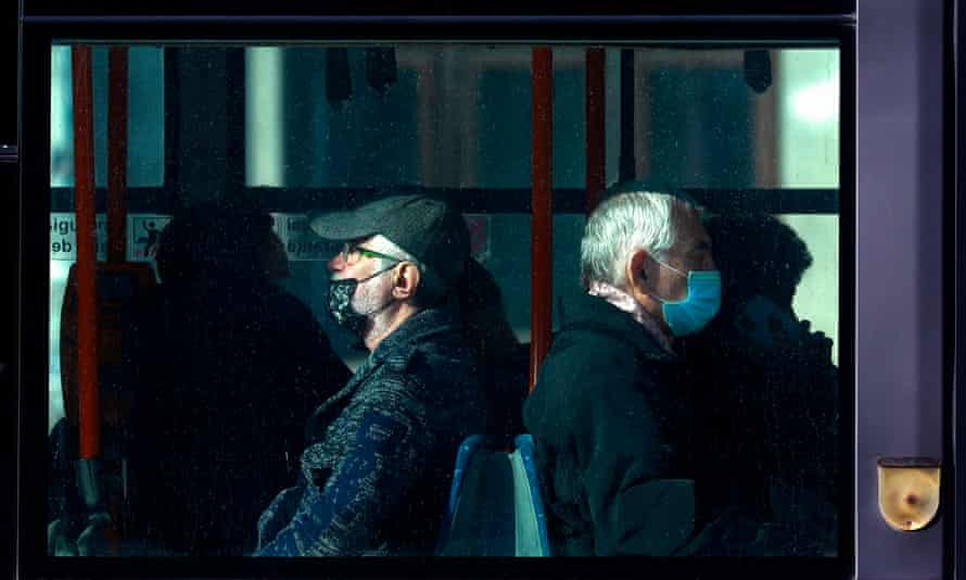 Two men take a bus in Bucharest