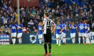 Mario Mandzukic looks on as Sampdoria celebrate their second goal of the game.