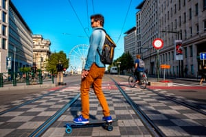 Brussels, Belgium. A man skates across a car free street in the Belgian capital