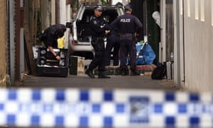 Police collect evidence outside a house in Surry Hills on Sunday after it was raided in a major joint counter-terrorism operation.
