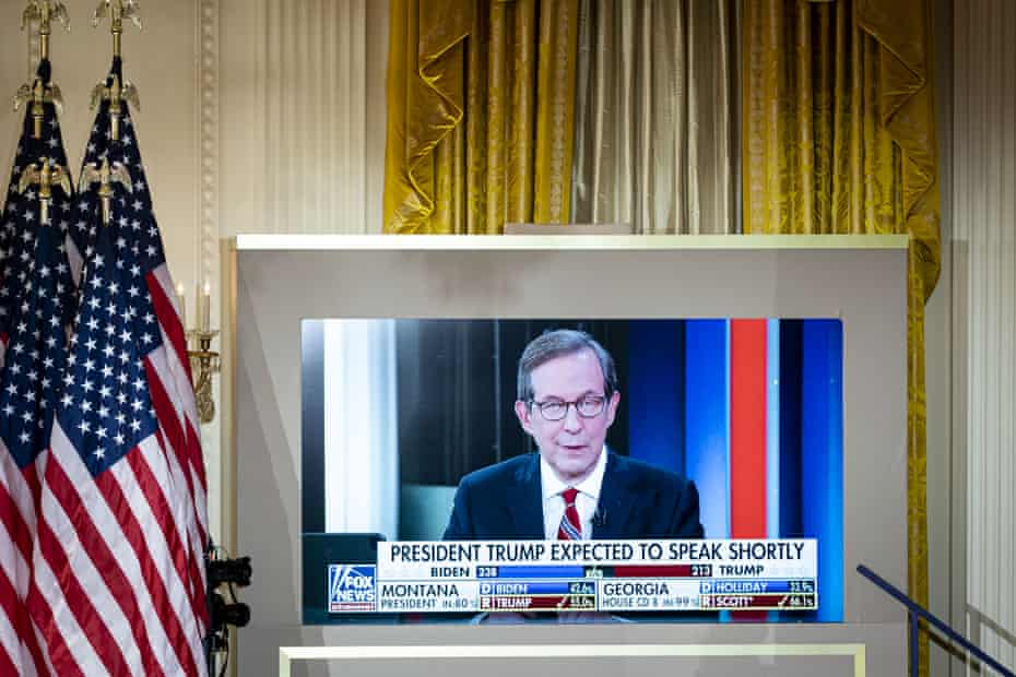 Chris Wallace of Fox News is displayed on a monitor during an election night party in the East Room of the White House on 4 November.