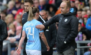 Keira Walsh is given a consoling pat by Manchester City's manager Nick Cushing after being sent off against Manchester United.