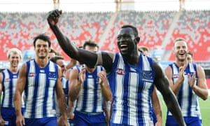 Majak Daw reacts as he leads Kangaroos players from the field following the AFL match between North Melbourne and Adelaide