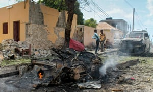 Somali security officers at the scene of a car bomb attack at the African Union base in Mogadishu on Tuesday.