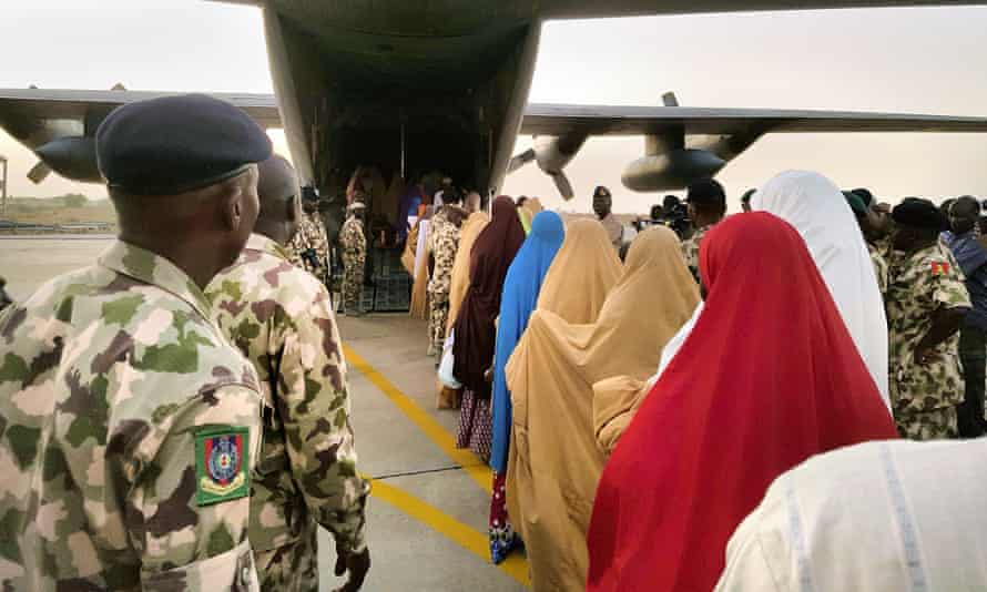 Schoolgirls kidnapped from Dapchi board a military plane following a handover to government officials in Maiduguri on 21 March.