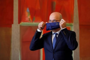 Portugal's finance minister Joao Leao takes off his protective mask during an interview with Reuters in Lisbon, Portugal, on 6 January 2021.