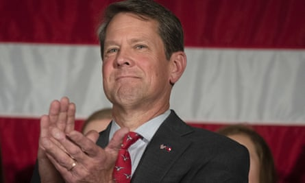 Georgia's secretary of state Brian Kemp. Stacey Abrams has accused her Republican opponent of creating a 'miasma of fear' around voting.
