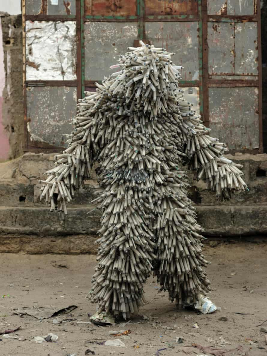 Flory Sinanduku with his costume made of syringes.