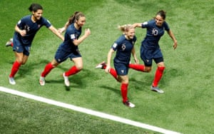 France's Eugenie Le Sommer celebrates with teammates after scoring their second goal from the penalty spot.