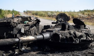 A destroyed tank on the road to Ilovaisk, on 3 September 2014.