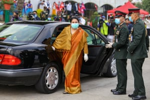 Nepal's president, Bidhya Devi Bhandari, wears a mask and gloves on her arrival at the parliament in Kathmandu