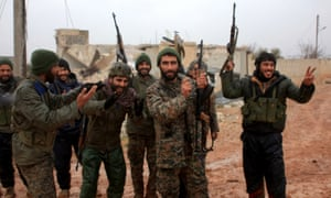 Syrian government soldiers celebrate after taking control of Ratian, north of Aleppo, from rebel fighters on Saturday.