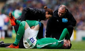 Kyle Lafferty receives medical attention.
