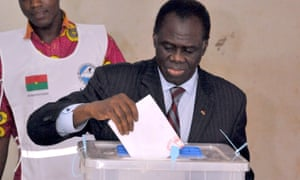 Burkina Faso's transitional president Michel Kafando casts his vote for the presidential election at a polling station in Ouagadougou.