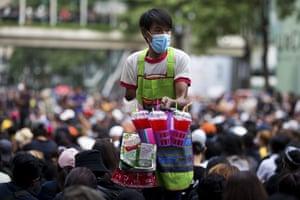 Bangkok, Thailand. A vendor sells drinks at an anti-government rally
