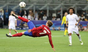 Antoine Griezmann attempts the spectacular but his shot goes well wide.
