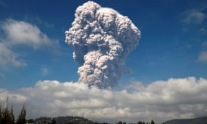 Ash from the Mount Sinabung volcano rises several kilometres into the sky.