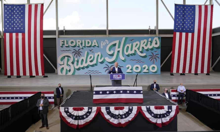 Biden addresses a drive-in rally in Miramar, Florida on Tuesday.