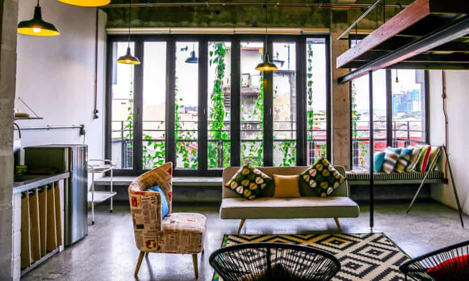 An industrial-chic style bedroom with exposed brick walls at SeKkeping Kong Heng, Malaysia