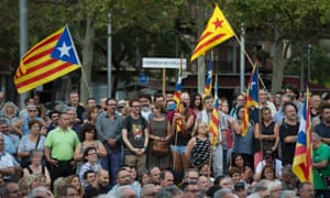 People holding Catalan pro-independence estelada flags