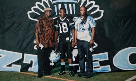 Kendrec McDade with his mother Anya Slaughter and his paternal grandfather.