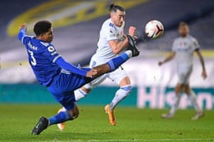 Wesley Fofana stretches out a leg to nullify the threat from Leeds United's Jack Harrison.