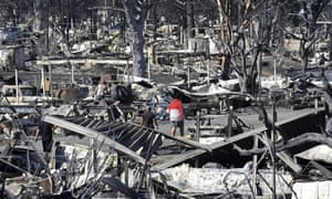 Men walk through the fire-ravaged Coleman Creek Estates mobile home park in Phoenix, Oregon on Wednesday.