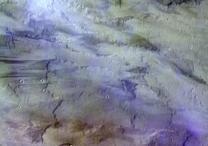 Staying on Mars, this image of clouds over lava flows taken by the ExoMars Trace Gas Orbiter back in November 2016 was released in October 2017. Capturing the Tharsis volcanic region, clouds, most likely of water-ice, and atmospheric haze in the sky are coloured blue/white in this image. Below, 630 km west of the volcano Arsia Mons, the southernmost of the Tharsis volcanoes, outlines of ancient lava flows dominate the surface. The dark streaks are due to the action of wind on the dark-coloured basaltic sands, while redder patches are wind blown dust.Some small impact craters can also be seen.
