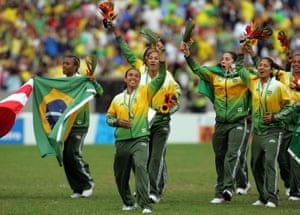Marta Silve (centre) and members of the Brazil team celebrate their 5-0 win against the USA.
