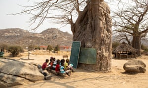 The work of the women of the Halo Trust has helped secure the safety of the children of the village, including these attending school lessons.