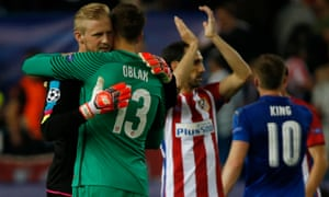 Leicester City's Kasper Schmeichel and Atletico Madrid's Jan Oblak embrace after the final whistle.