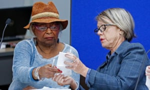 Brenda Snipes, left, speaks with Judge Betsy Benson, canvassing board chair, before the start of a recount of all votes in Broward county.