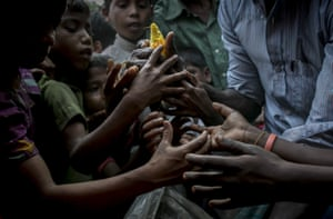 Children gather around the crew of the Nautical Aliya in the Leda refugee camp