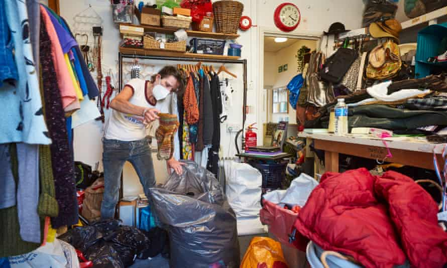 A member of staff sorts through donations at the Scope charity shop in Walthamstow, north-east London.