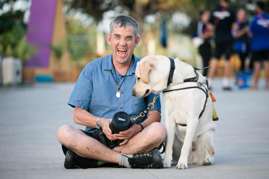 Andrew Follows with his guide dog Leo at the 2018 Commonwealth Games