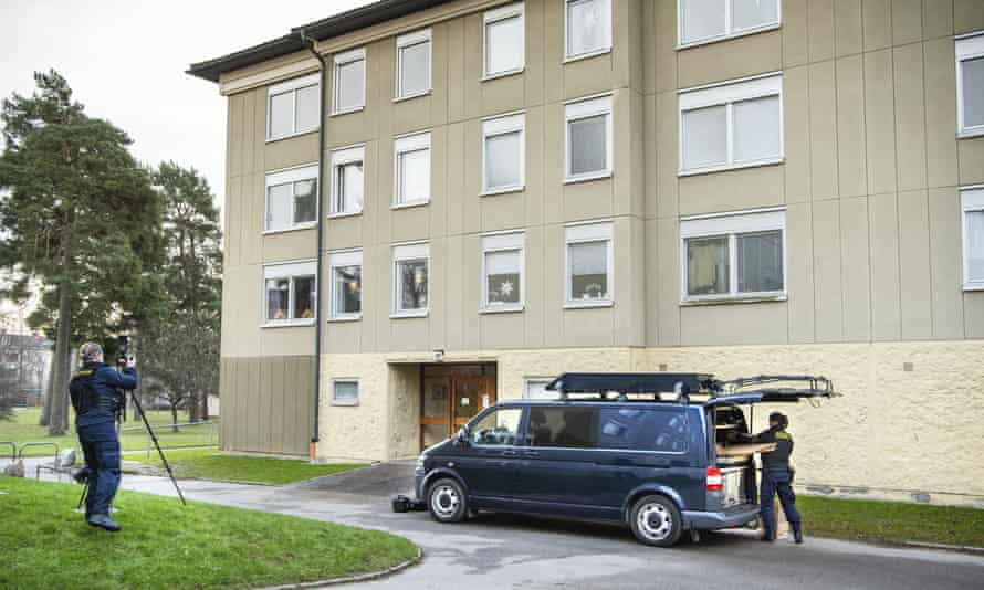 Police at the apartment block in Haninge, south of Stockholm, on 1 December where the woman was alleged to have kept her son confined.