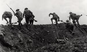 Soldiers climbing over their trench on the first day of the battle of the Somme, July 1916
