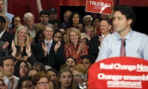 Newly elected Ottawa area Liberal members of parliament, left to right, Catherine McKenna, Andrew Leslie, Karen McCrimmon, and David McGuinty listen to Liberal leader and Canada's prime minister-designate Justin Trudeau.