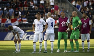 USA players look glum after their loss at PPL Park.