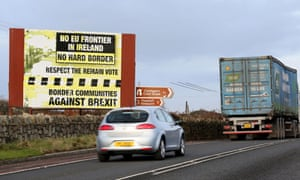 Traffic passes a Brexit Border poster on the Dublin road Co Armagh border, between Newry in Northern Ireland and Dundalk in the Irish Republic